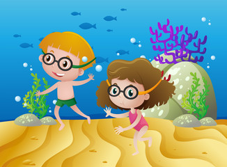 Two kids diving under the sea