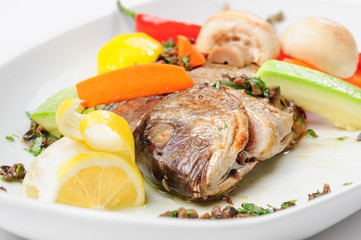 Roasted dorada fish with vegetables