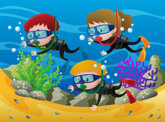 Three kids scuba diving under the sea