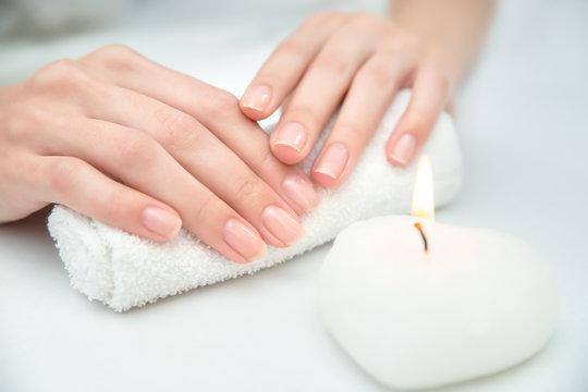 Woman getting nail manicure.