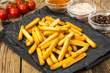 Crispy bread sticks with salt and spices