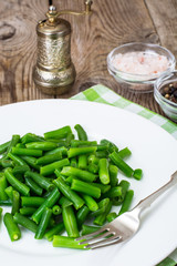 Salad of green beans on white plate