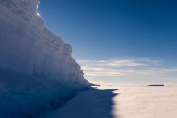 Sun peeking over ice wall
