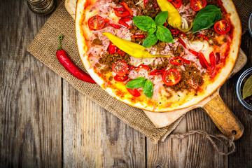Rustic Italian Pizza on a Thin Pastry with Minced Pork, Ham, Tom