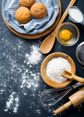 Baking ingredients. Bowl, eggs, flour, eggbeater, rolling pin an
