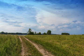 rural landscape with country road, the sky before the storm