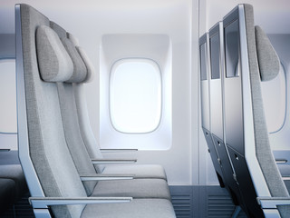 Gray airplane seats in the cabin. 3d rendering