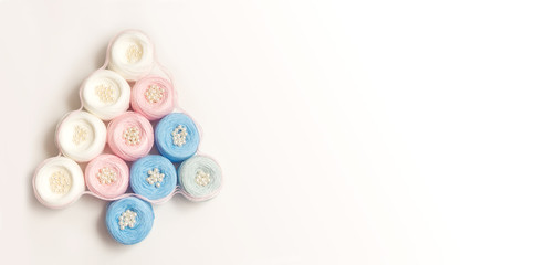 colorful balls of yarn on a white background
