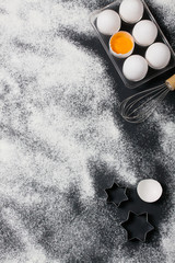 Baking background with eggs, rolling pin and star cookie cutters