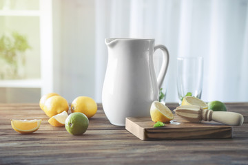 Jug with lemonade on wooden kitchen  table