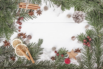 Christmas white wooden background with fir branches top view. Sp