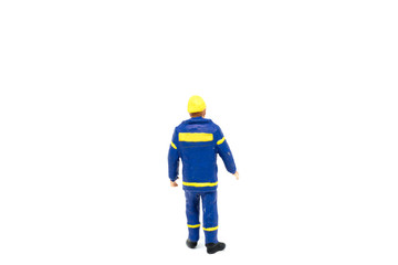 Miniature people engineer worker construction on white background