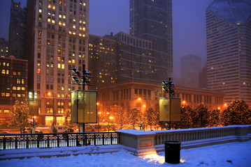 Chicago winter cityscape. Cityscape with snowfall and street lights in the center of Chicago. Beautiful winter night in Chicago, Illinois, USA.