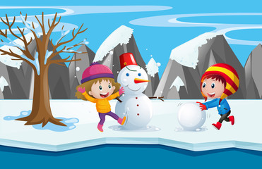 Two kids playing with the snowman