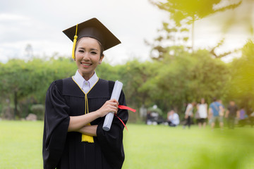 Graduate holding certificate in her hand and feeling so happiness in Commencement day
