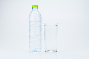 Water bottle and glass of full water on white background