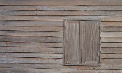 wooden wimdow on old wooden wall