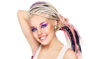 Young beautiful happy smiling girl with dreadlocks over white background, cope space