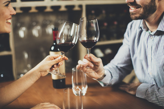 Handsome young couple on the date in wine bar