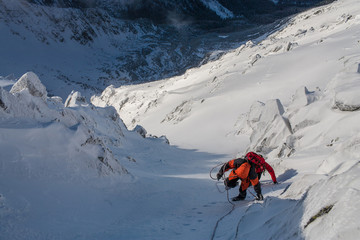 Mountaineering. Teamwork in alpinism.  Traverse of mountain.