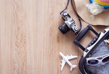 Traveler baggage and retro camera with copy space