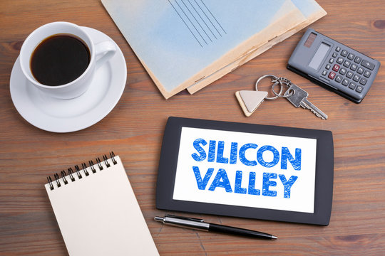 Silicon Valley. Text on tablet device on a wooden table