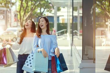 Two young women shopping in mall .concept of women shopping