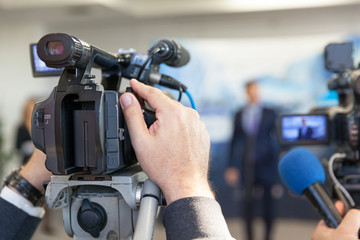 Blurred spokesman at press conference