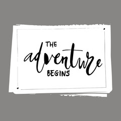 The adventure begins card. Isolated on white background. Hand drawn lettering .