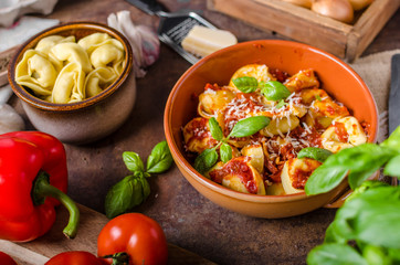 Homemade tortellini with tomato sauce