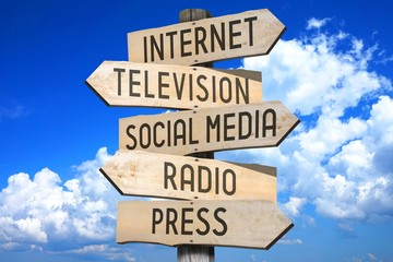 Wooden signpost - media concept (Internet, television, social media, radio, press).
