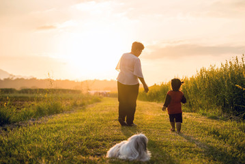 Grandmother, daughter and a dog with happy family enjoying life