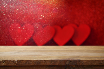 Valentines day concept. Empty table in front of glitter red hearts