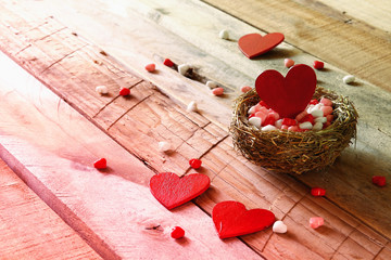 Valentines day background. Couple of red hearts in the bird nest