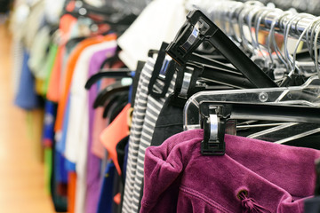 Women's pants hanging on clothing rack