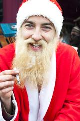 Santa smoking a cigarette