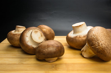 mushroom champignons on a wooden Board