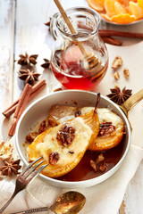Baked pears with honey stuffed with gorgonzola cheese and walnuts