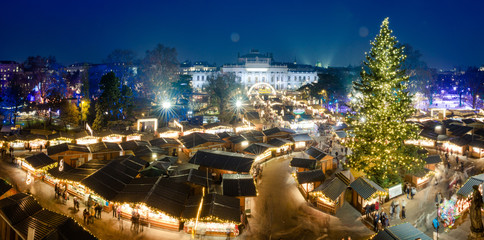 Vienna Christmas Market Panorama at night, aerial view with blue sky