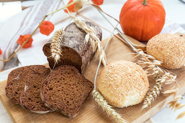 Freshly baked breads with ears and pumpkin. Shallow depth of field. Coloring and processing photo.