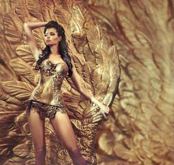 Poster Artist KB Glamorous woman posing over the huge golden wing