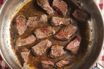 beef pieces browning in a pot