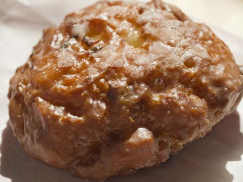 An apple fritter, a popular American sweet