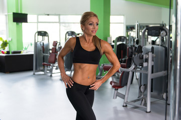 Healthy Middle Age Woman Flexing Muscles