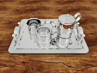 3D render of a silver teacup with cups  on a wooden surface