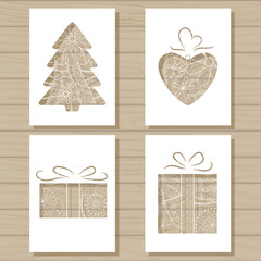 Christmas set of stencil templates on wooden background