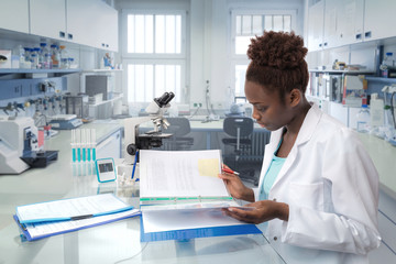 African scientist, medical worker or tech in modern laboratory