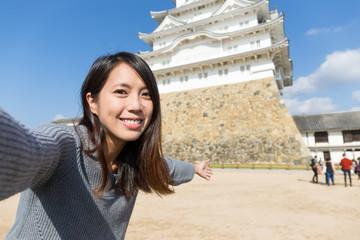 Woman taking picture in Himeji Castle