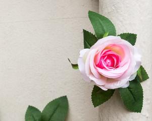 Artificial pink rose.