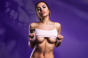 Sexy Woman Posing In White Shirt Isolated On The Violet Background